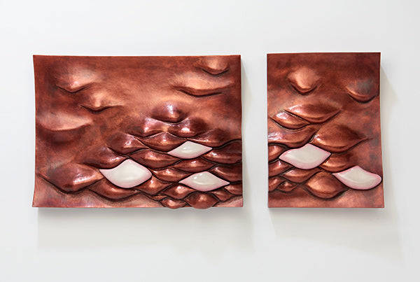 2 part copper and pink enamel wall sculpture with relief style droops and bulges