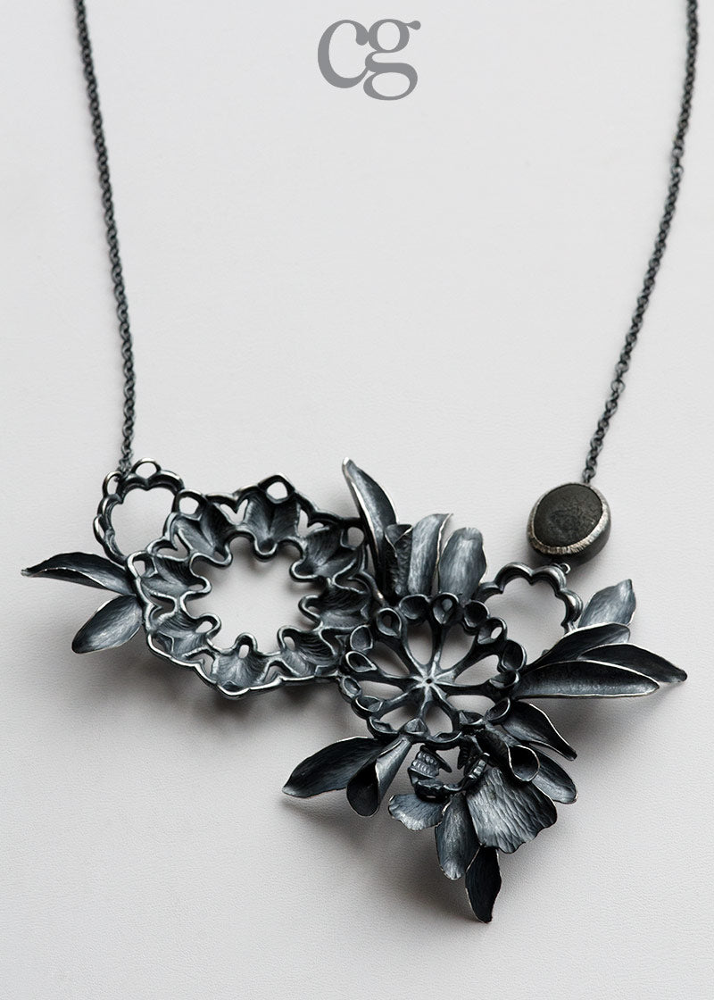 one of a kind blackened sterling silver necklace inspired by forest and beach made by hand in Seattle by artist Catherine Grisez