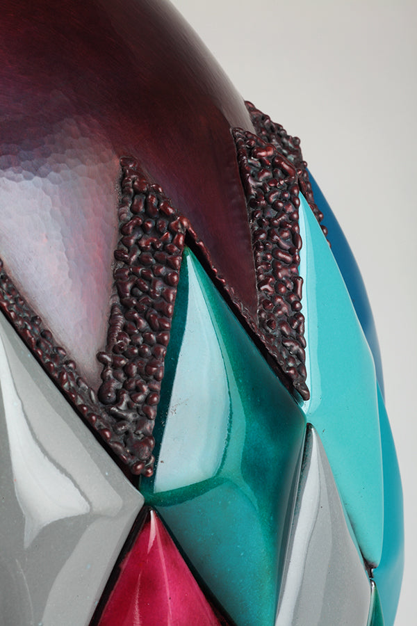 detail of aqua diamond enamelware and hammered copper sculpture