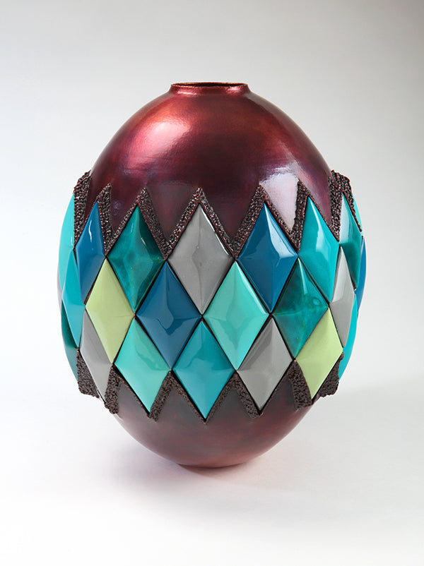 hammered copper vessel with blue green yellow diamonds contemporary sculpture