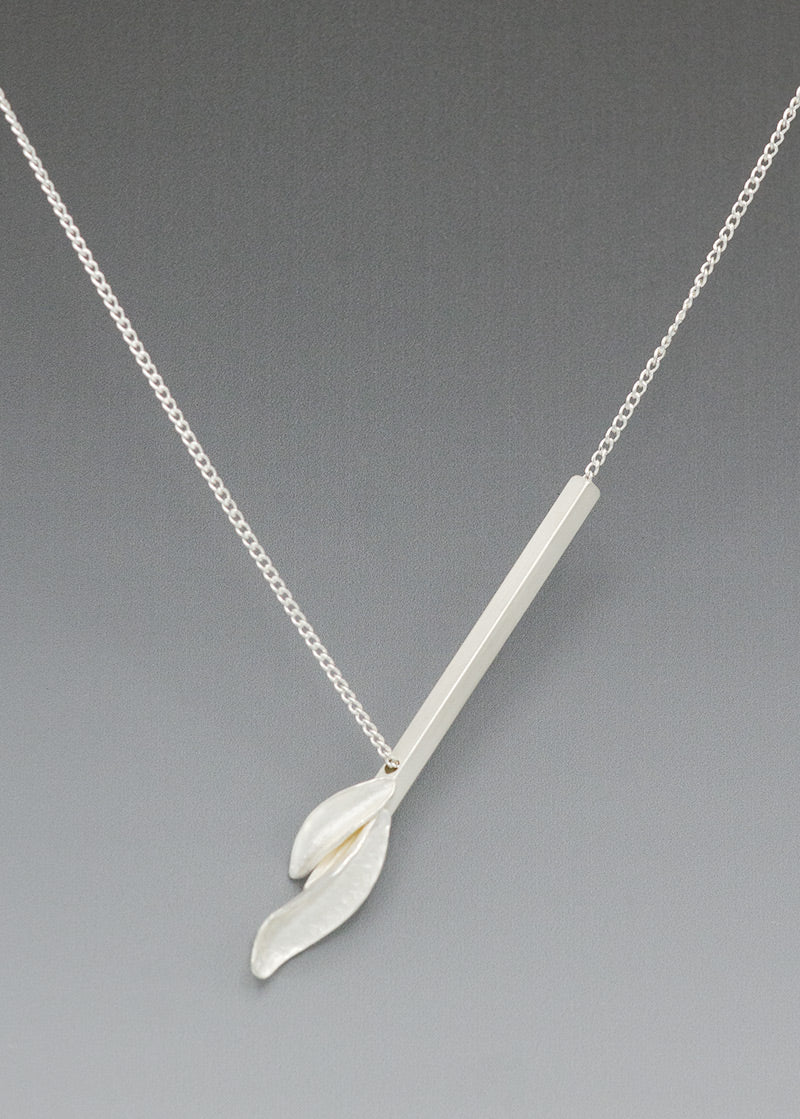 Resilient silver flame necklace