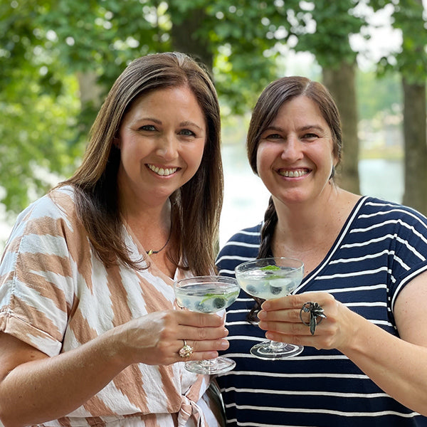 Sarah and Catherine toasting togetherness with Simple Goodness Sisters cocktails and CG statement rings