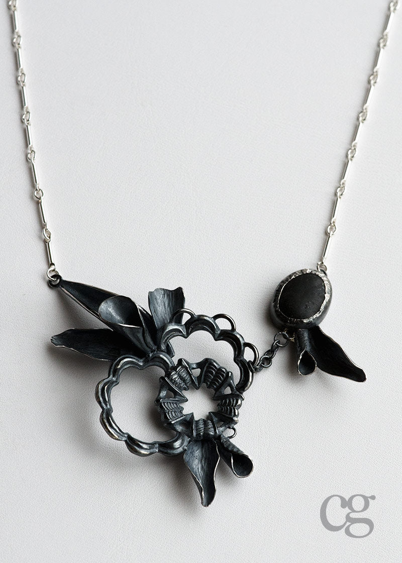 one of a kind darkened sterling silver and beach rock necklace inspired by the ocean and made in Seattle by artist Catherine Grisez
