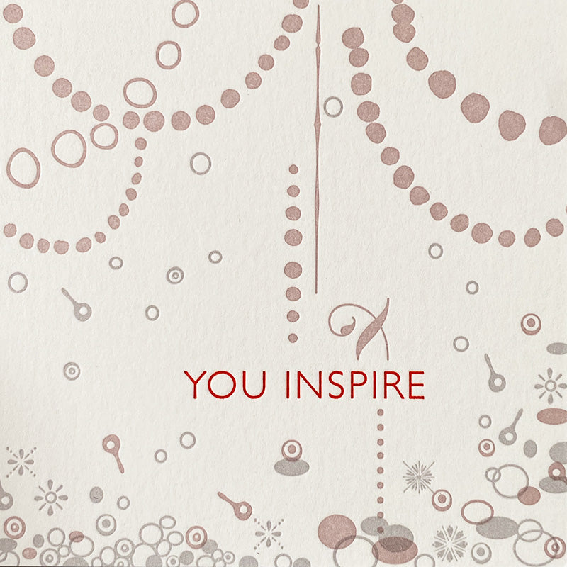 You inspire details of handmade custom Letterpress card for Inspiring Women necklace award by CG Sculpture and Jewelry