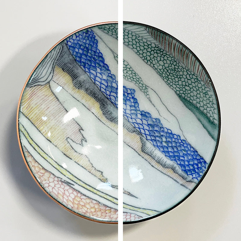 enamelware copper bowl with abstract landscape drawing showing 2 versions of edge treatment, black or copper