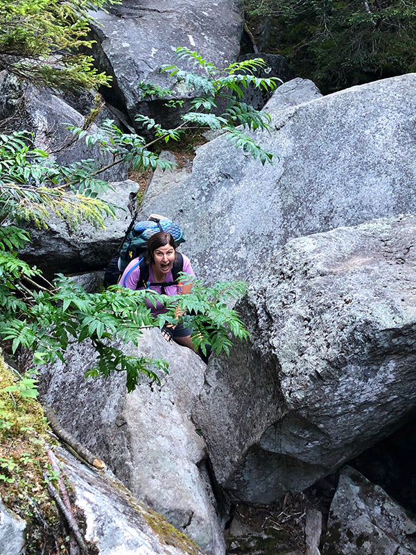 catherine stuck in mahoosuc knotch while backpacking the appalachian trail