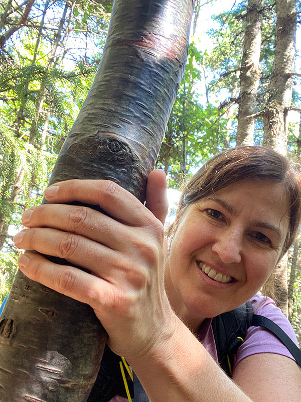 catherine assisted by tree while backpacking on the appalachian trail