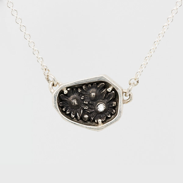 diamond and silver rock necklace to represent strength and inner beauty by artist Catherine Grisez