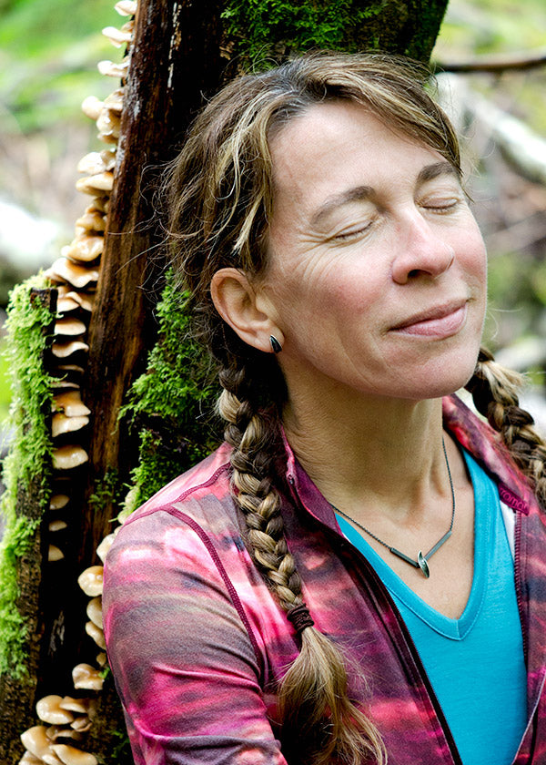Wendy resting with mushroom tree, forest bathing and art inspiration in nature