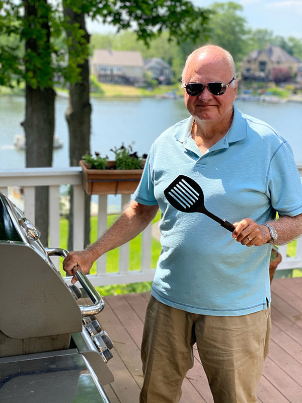 frank grisez at the grill on sunny deck