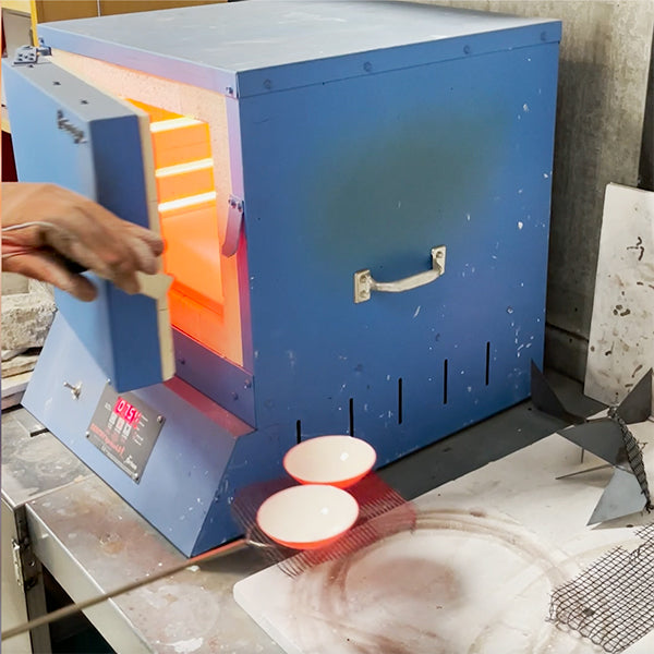fusing glass to copper bowls in 1500 degree kiln for salt cellars handcrafted by Seattle artist Catherine Grisez