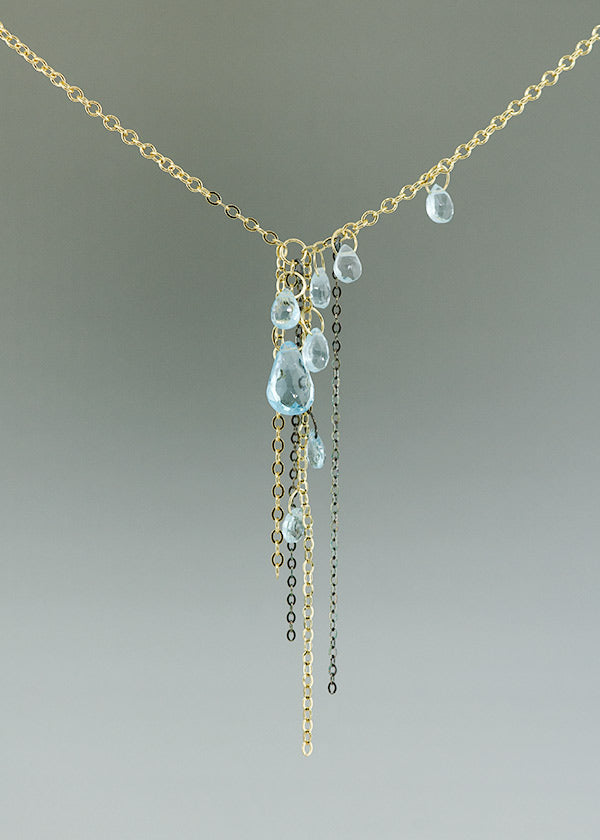 blue topaz, 14k gold, and black silver necklace handcrafted by seattle artist Catherine Grisez