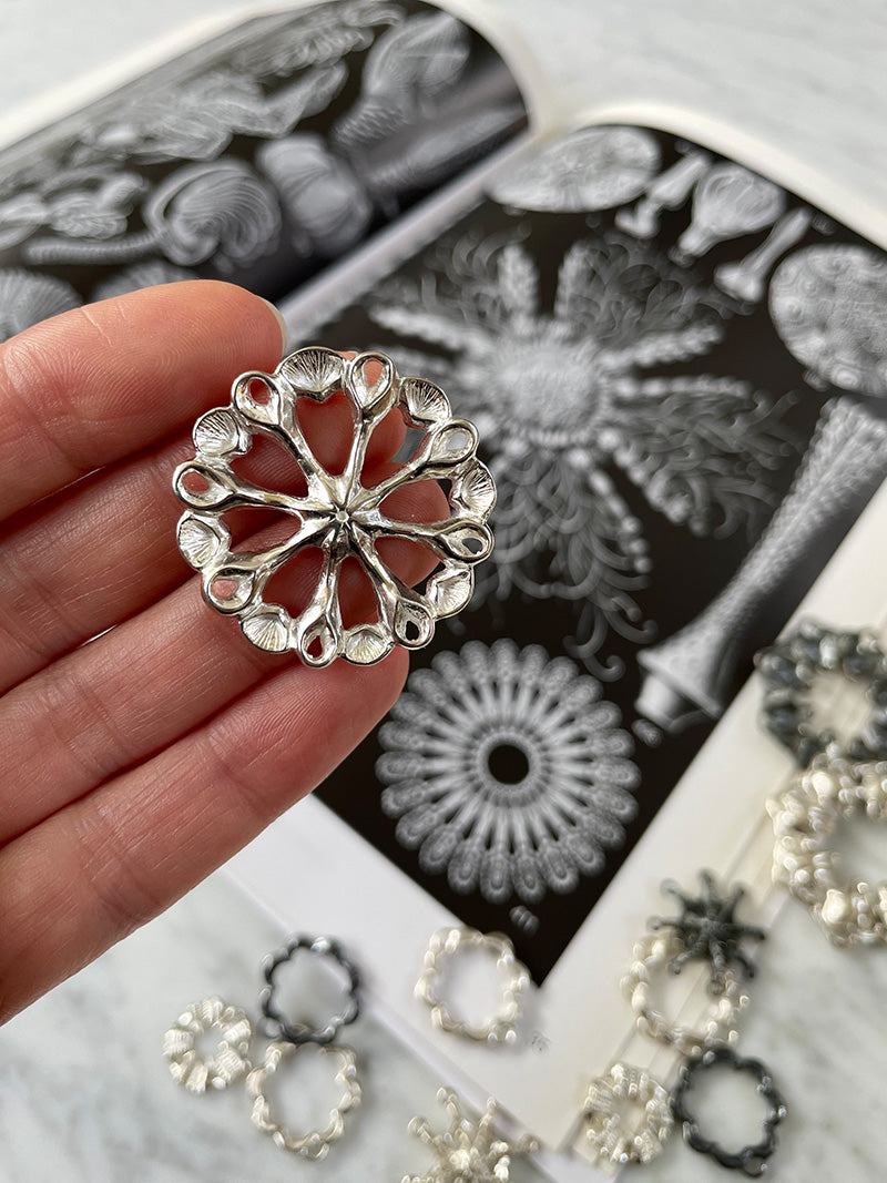 sterling silver hand carved jewelry part inspired by ernst haeckel drawing