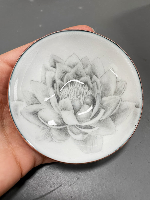 hand drawn lotus flower embedded in glass and copper bowl, a gift to represent new beginnings handcrafted by artist Catherine Grisez