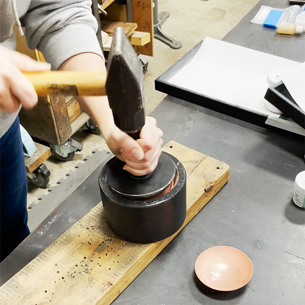 hammering little copper bowls for salt cellars or spice bowls CG Sculpture and Jewelry