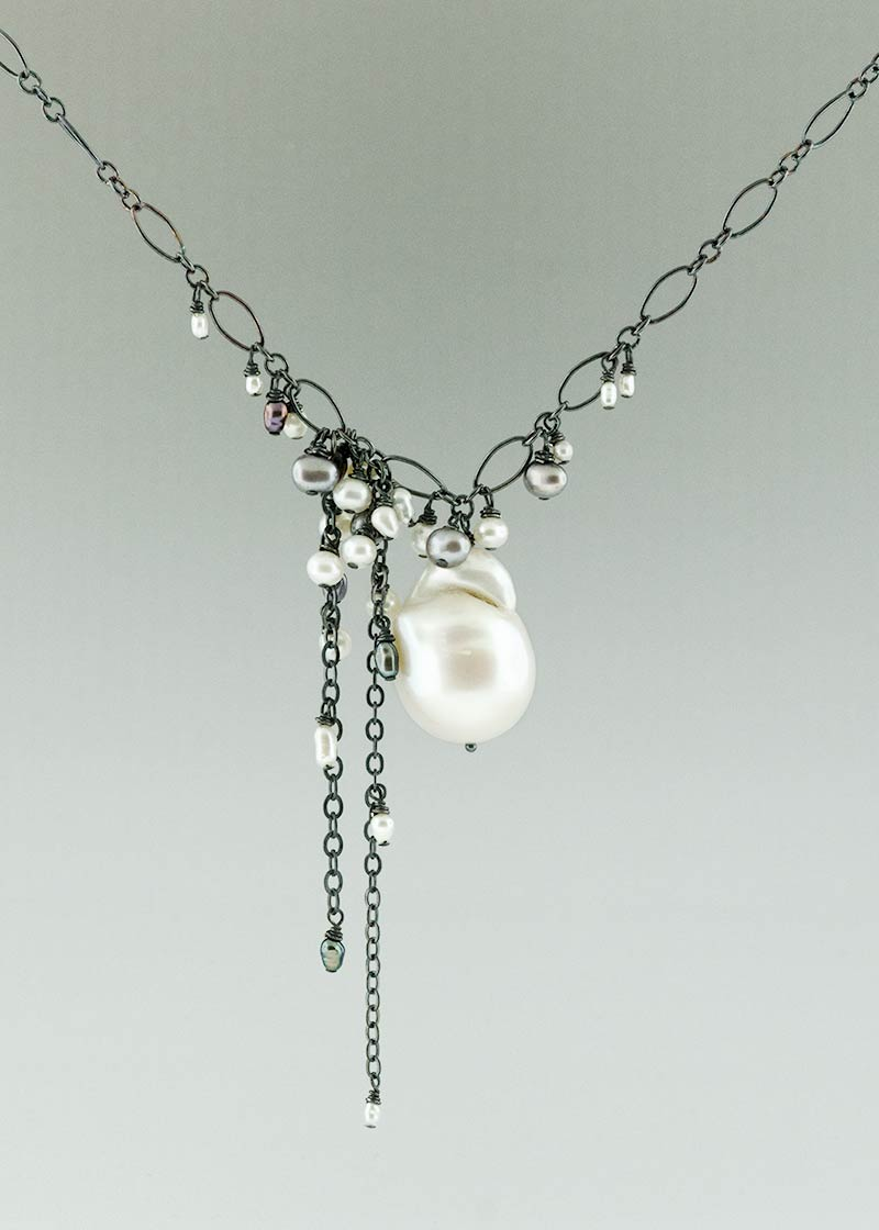 white baroque pearl and black sterling silver asymmetrical necklace made by CG Sculpture and Jewelry