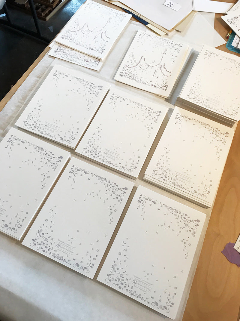 stacks of letterpress cards by Orange House Press in process for CG Sculpture and Jewelry