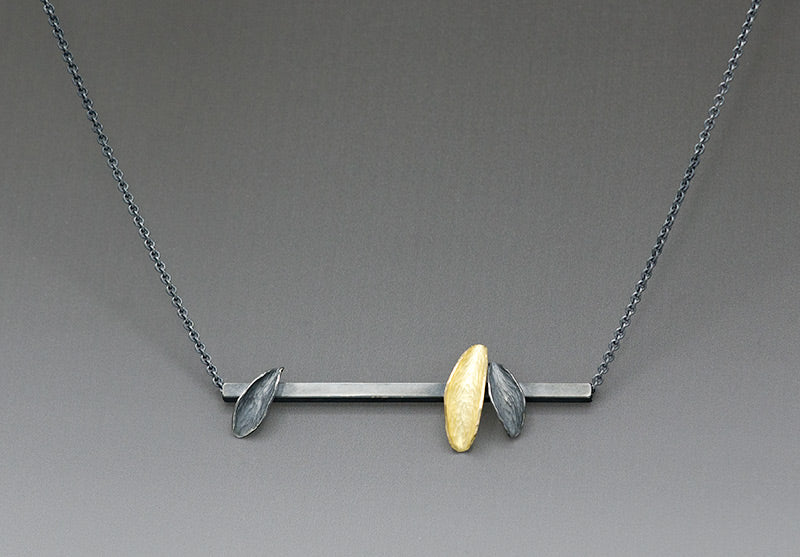 blackened silver and yellow gold modern necklace inspired by backpacking trip, thrive despite adversity
