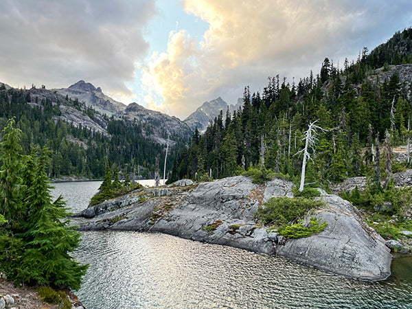 Dramatic sky over Spectacle Lake on PCT backpacking adventure