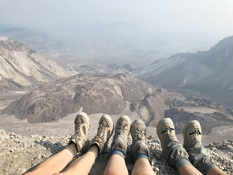 dirty boots at the top of Mt St Helens overlooking crater, hike that inspired Resilient nature jewelry collection