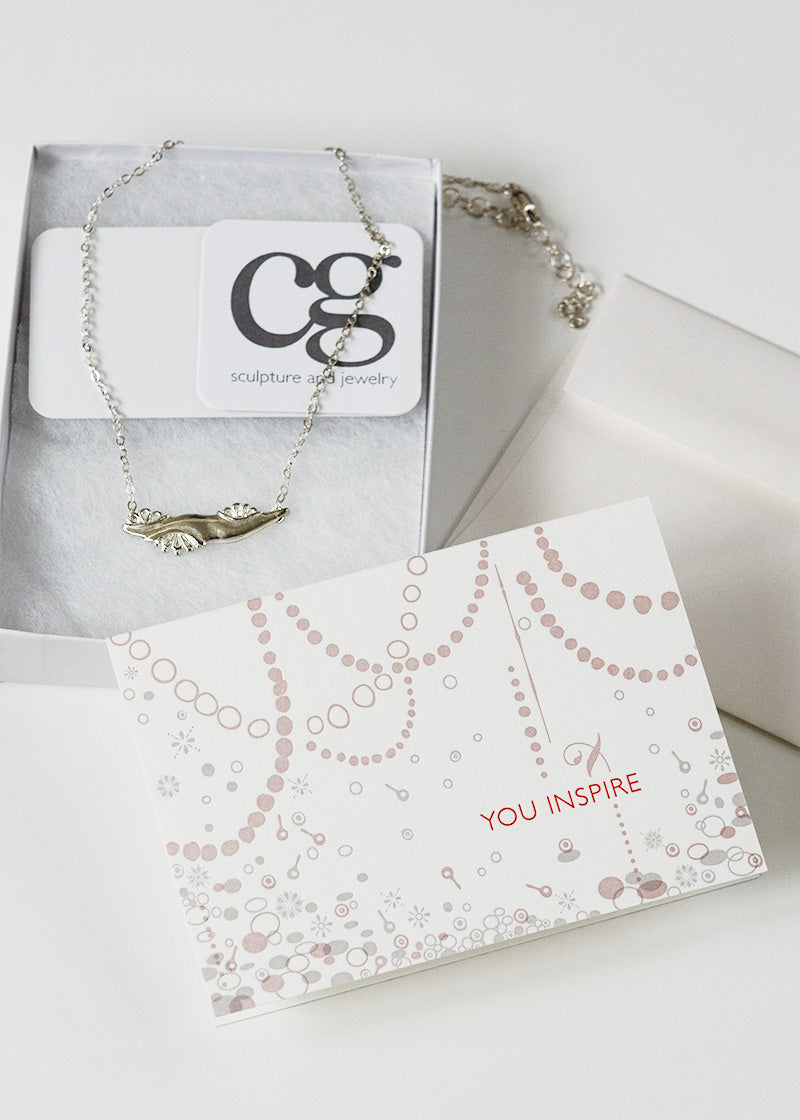 custom letterpress card by Orange House Press for Inspiring Women Project silver necklace award by CG Sculpture and Jewelry