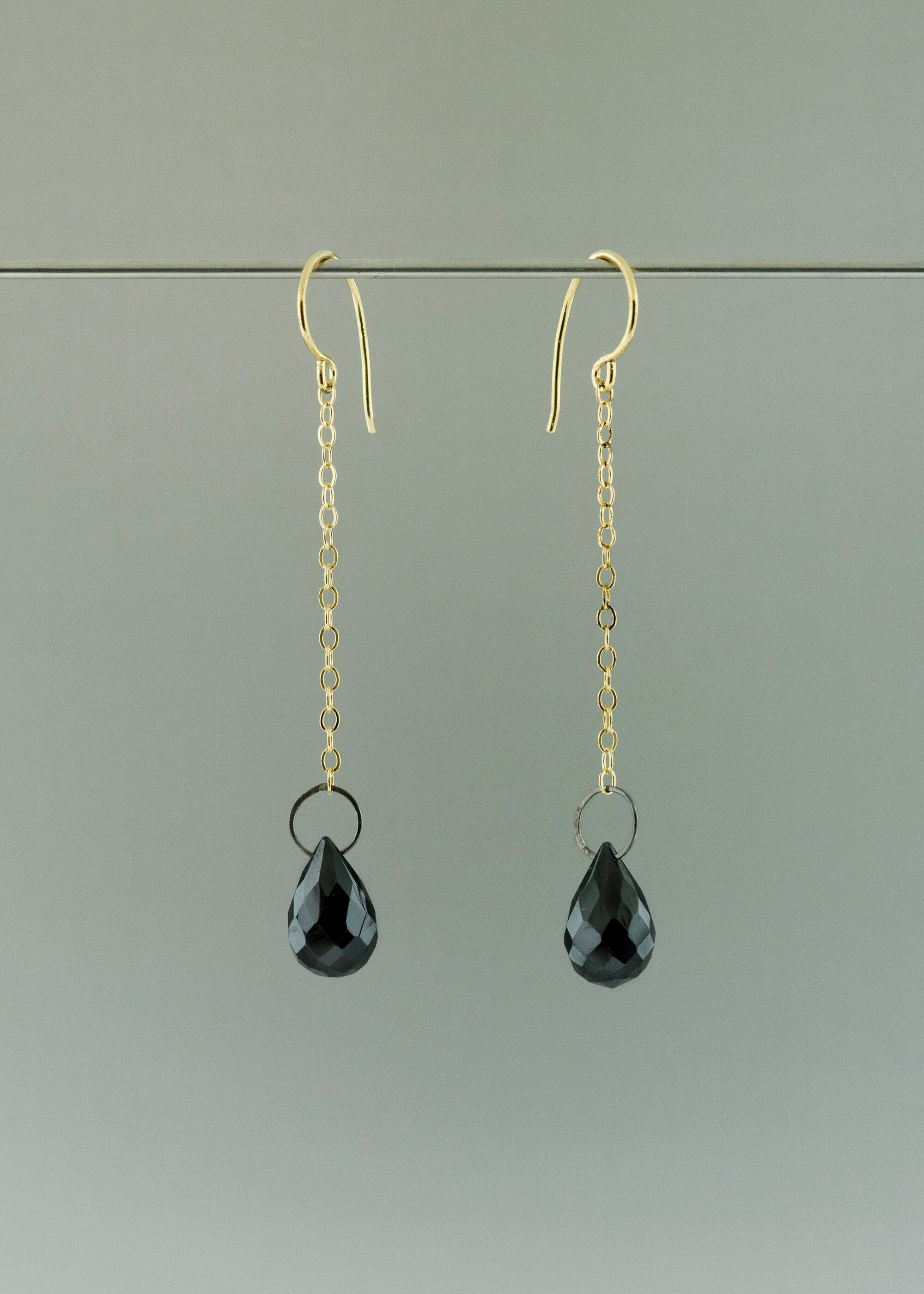 Black and gold drop earring