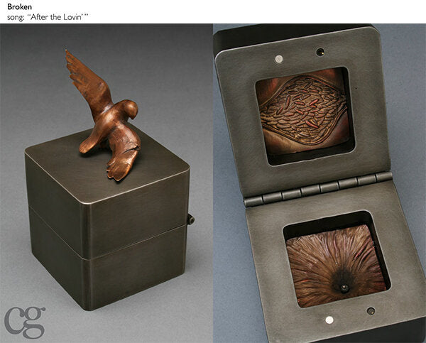 Broken steel and bronze bird music box sculpture with lava and bird with broken wing