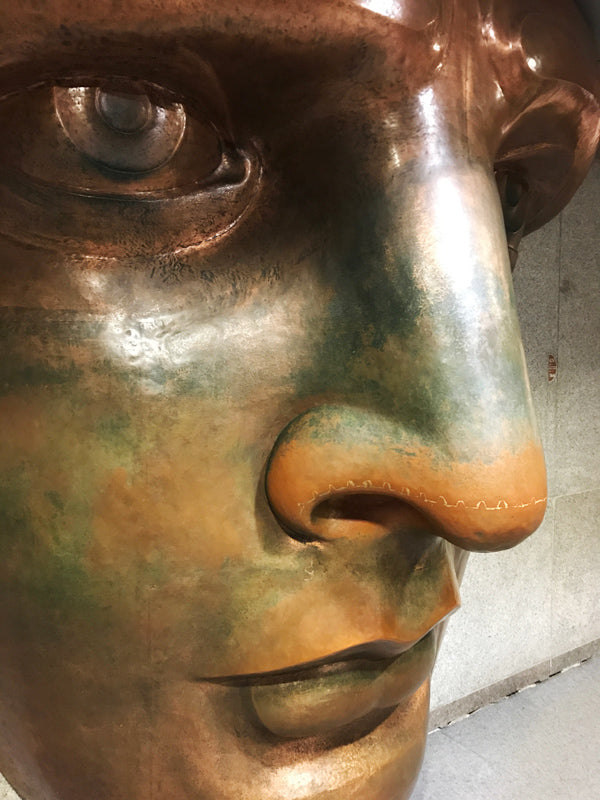 A replica of her face. At more than 8' tall this is copper forming at a most impressive scale.