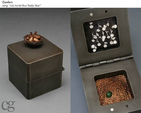 bronze bird nest and steel and silver and jade music box sculpture
