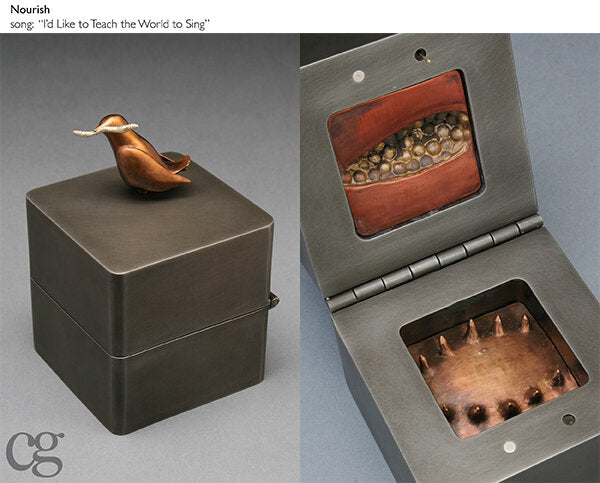 bronze bird with silver worm on steel music box sculpture and pomegranate texture symbolizing abundance and health