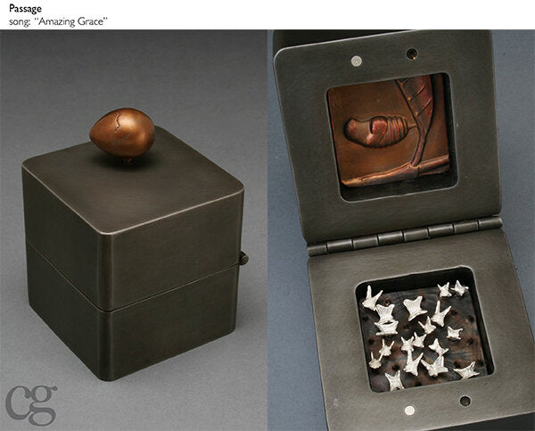 bronze egg with silver butterflies commemorating death - music box sculpture plays amazing grace