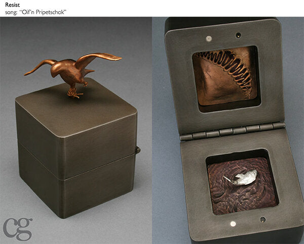 bird in flight with tied leg bronze and steel music box sculpture with silver fish out of water