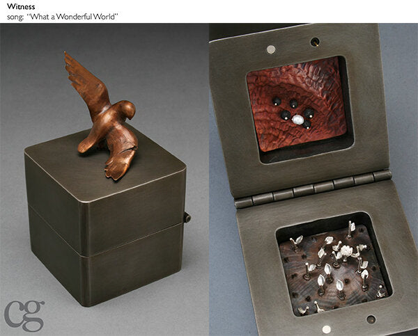 steel and silver and bronze bird with broken wing music box sculpture called Witness
