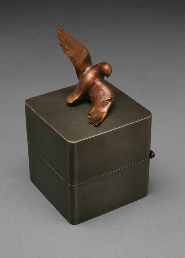 Steel and bronze bird music box that plays the song, What a Wonderful World.