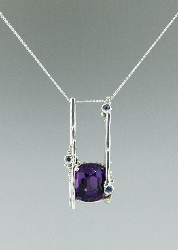 february birthstone amethyst and sapphire necklace celebrating first child. one of a kind custom jewelry design