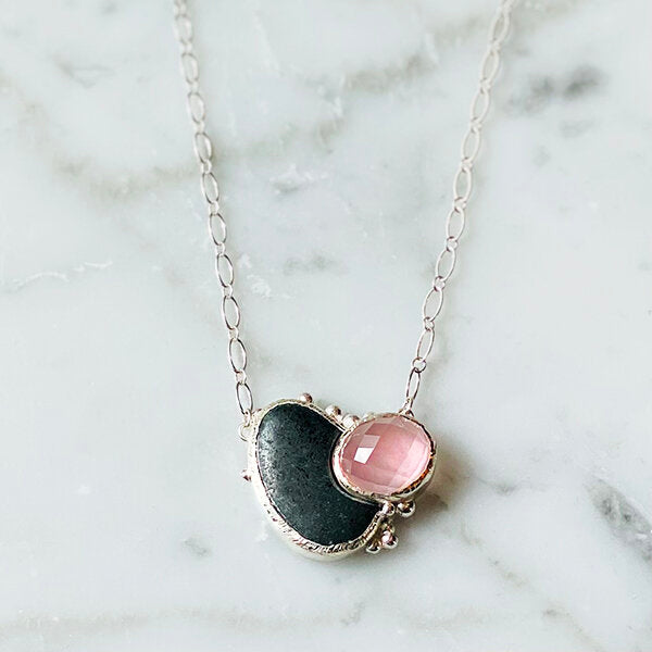 necklace to represent the fearless and feminine woman - black ocean rock and pink rose quartz set in sterling silver