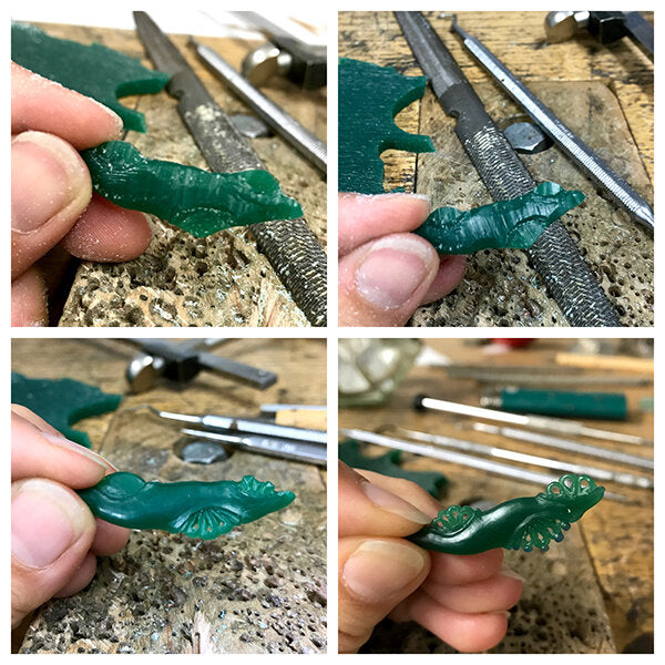 process of hand carving wax to cast in silver for Inspiring Women Project jewelry award