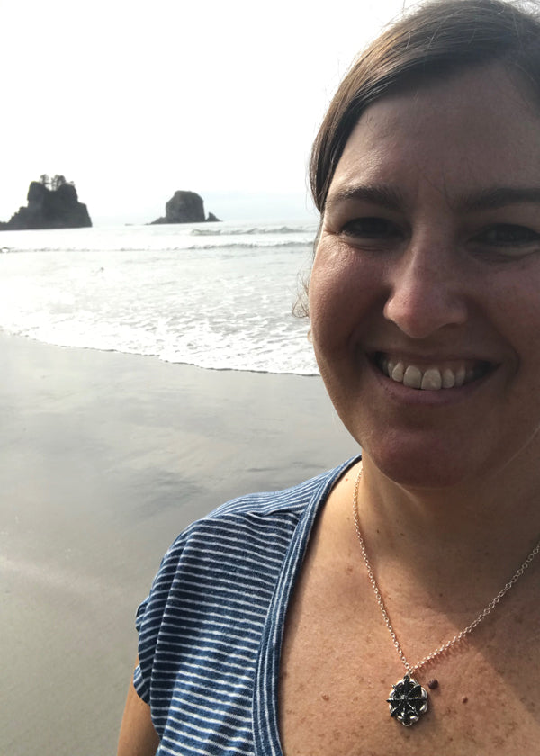 sea star nautical necklace with blue and white striped shirt worn at shi shi beack with sea stacks in the distance