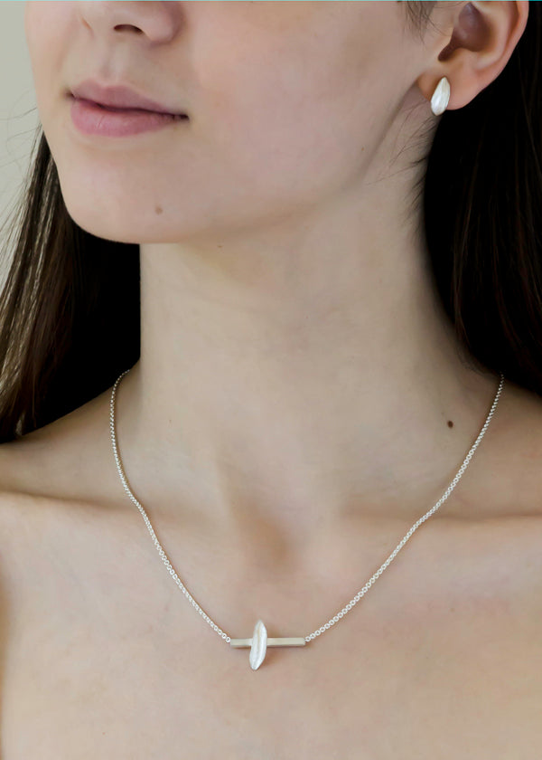 bright silver leaf hug earring and 1 leaf bar necklace perfect for everyday wear