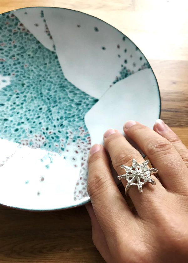turquoise pattern enamelware bowl and silver sea star ring inspired by sea creatures and barnacles