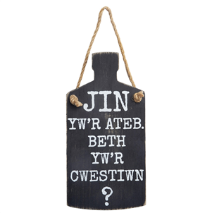 Welsh gin bottle-shaped sign|JIN yw'r ateb ....
