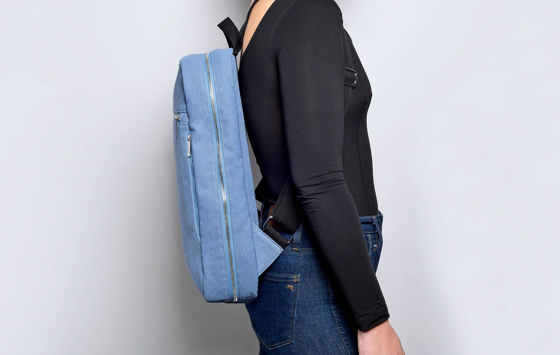 Blue Slate slimline backpack on model