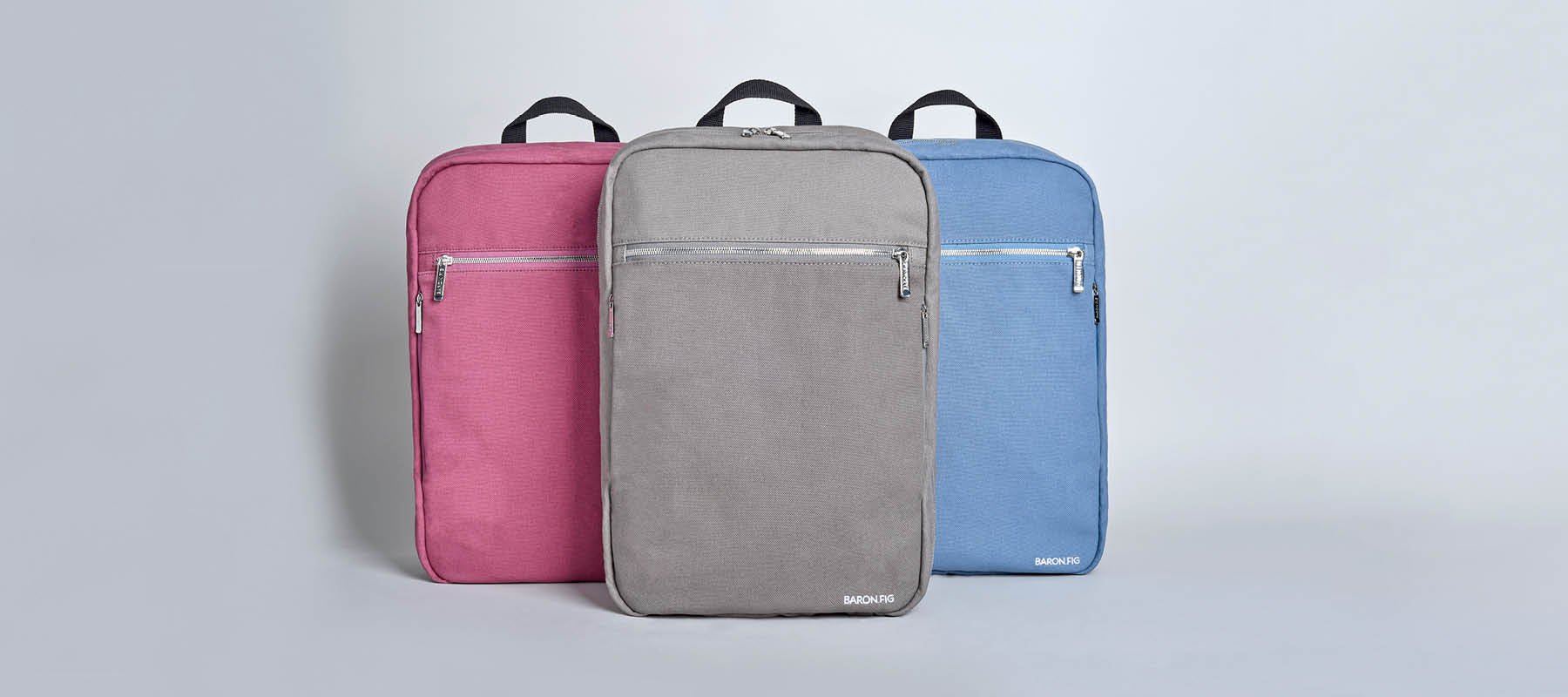 Fig wine, charcoal, and blue slate slimline backpacks