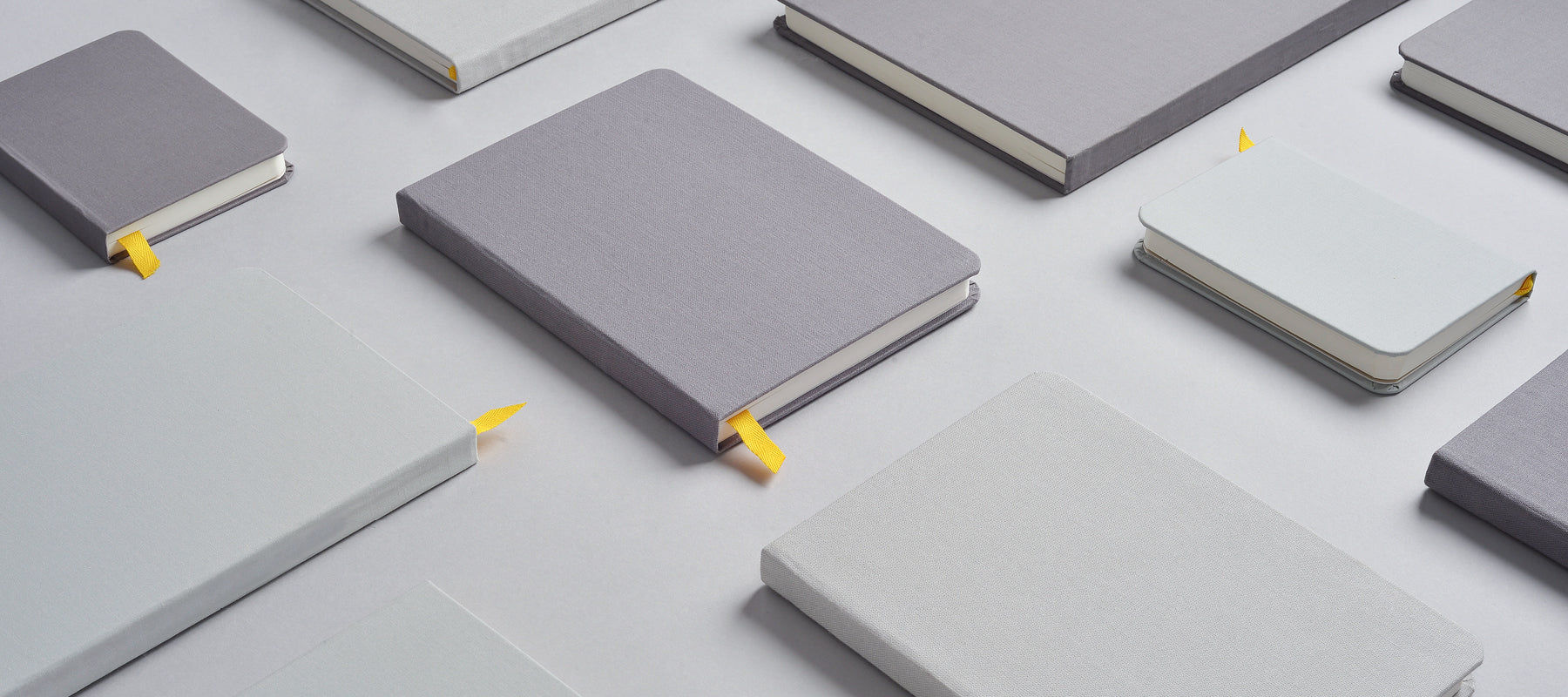 Assorted Confidant notebooks in charcoal and light gray