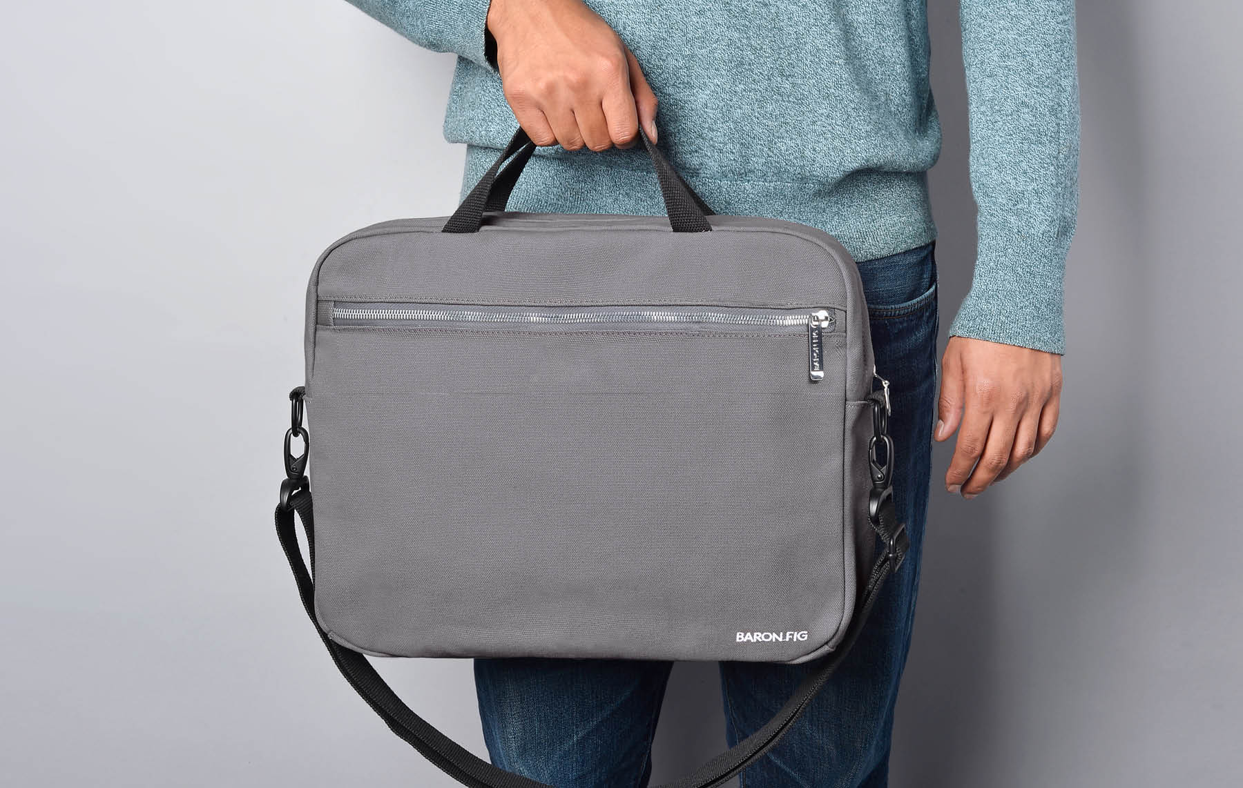 charcoal messenger bag on model
