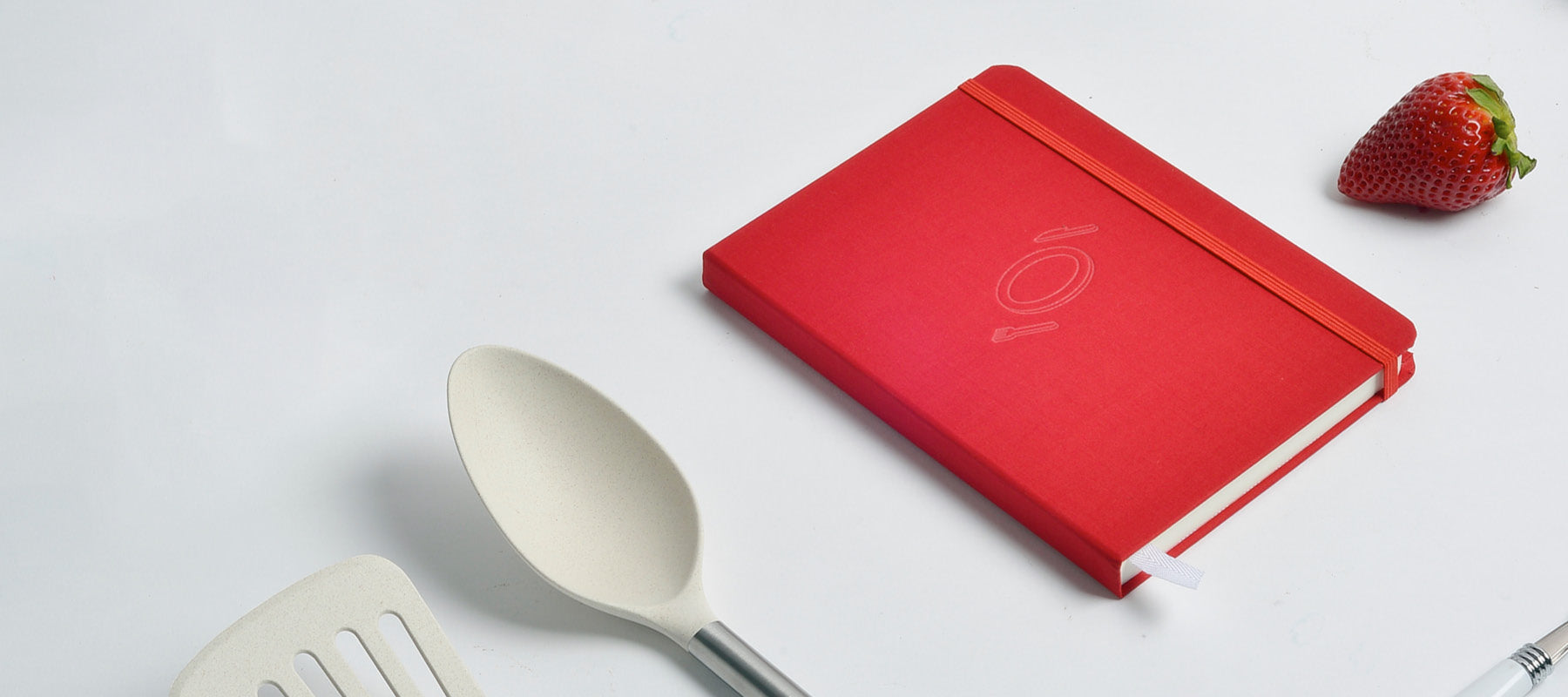 Savor Recipe Journal next to spoon and spatula