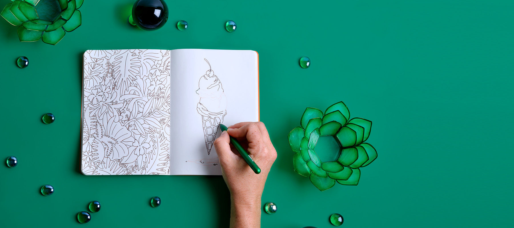 green softcover notebook opened flat