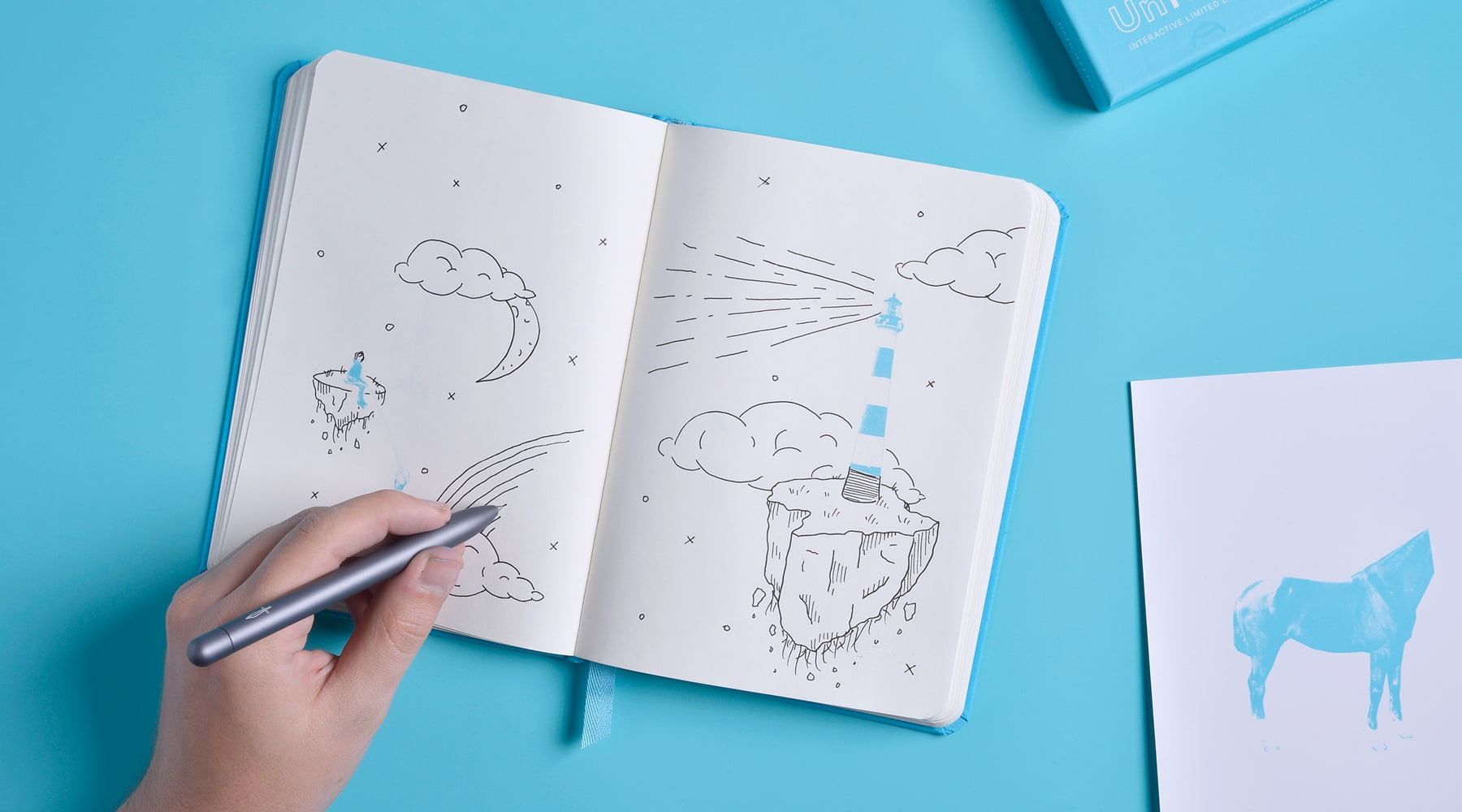 Open Unfinish notebook with drawing.