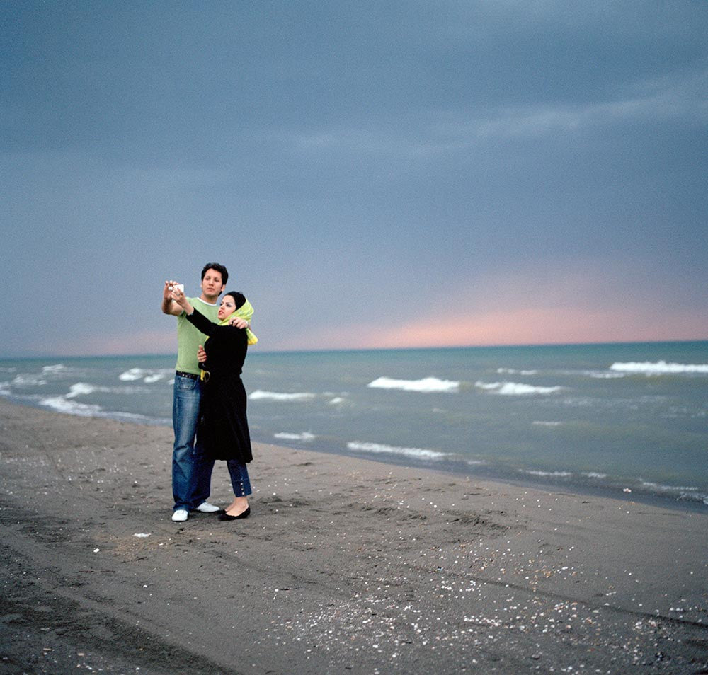 A couple in front of the Caspian Sea. Iran. 2007.