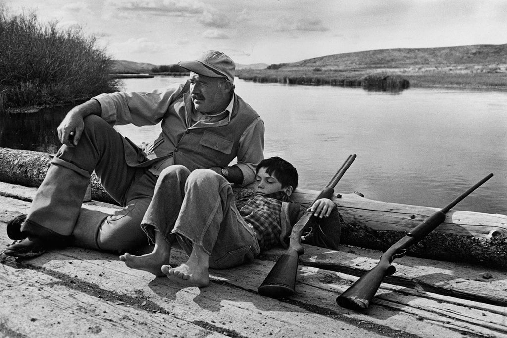 American writer Ernest Hemingway with his son Gregory. USA. October, 1941.